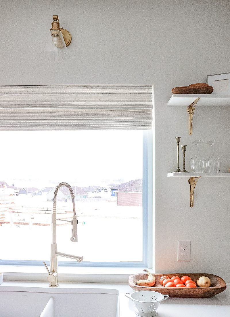 brass sconce in the kitchen window view